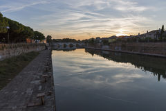 Bridge of Tiberius at sunset in Rimini, Italy. Royalty Free Stock Photography