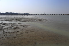 Bridge on tidal flat Stock Photo