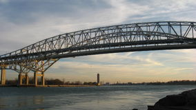 Bridge Timelapse Afternoon. The Blue Water Bridge connecting Port Huron, Michigan, USA with Sarnia, Ontario, Canada. The twin span bridge crosses the St. Clair stock footage
