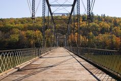 Bridge to autumn. Bridge over Delaware River between New York and Pennsylvania royalty free stock photography