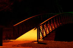 Bridge to Beyond. Night shot of arched walkway brindge seamingly leading to nowhere stock photos