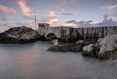 Bridge to the boat. Stone bridge located in Paço de Arcos ,Portugal Royalty Free Stock Photos