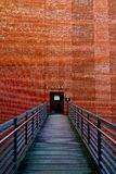 Bridge to a Brick wall with a door to open. In Hamburg Speicherstadt royalty free stock image