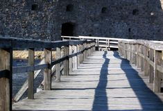 Bridge to the castle. A wooden bridge to a castle gate. Ruins of Kronoberg fortress in southern Sweden Royalty Free Stock Image