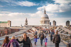 On the Bridge to the Cathedral. London, UK - April 7, 2015: the Millennium Bridge to the St Paul's Cathedral, two famous landmarks of London, with Pedestrians in stock photos