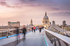The Bridge to the Cathedral in Twilight. The Millennium Bridge to the St Paul's Cathedral in Twilight with Moving People royalty free stock photo