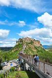 The bridge to Civita di Bagnoregio with tourists Stock Image