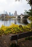 Bridge to Downtown Minneapolis. Bench overlooking downtown minneapolis skyline Royalty Free Stock Photos
