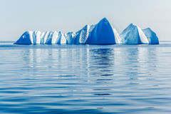 A grouping of blue icebergs in the Arctic ocean. A gathering of ice blue bergs float silently in the ice blue Arctic ocean royalty free stock photos