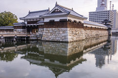 The bridge to entrance at hiroshima castle  with wall to protect Stock Photos