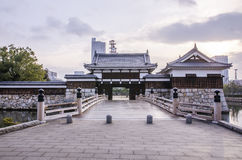 The bridge to entrance at hiroshima castle  with wall to protect Royalty Free Stock Images