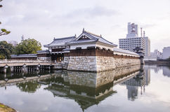 The bridge to entrance at hiroshima castle  with wall to protect Stock Image