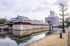 The bridge to entrance at hiroshima castle  with wall to protect Royalty Free Stock Photos