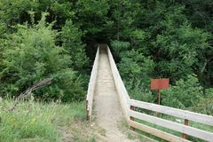 Bridge to the forest. In the Spanish Pyrenees Stock Images