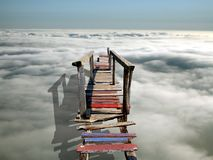 A bridge to heaven. A bridge over the clouds stock photos
