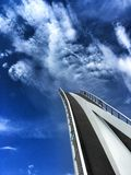 Bridge to heaven. Folding footpath bridge in Gdansk, Poland against dramatic sky Stock Image