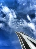 Bridge to heaven. Folding footpath bridge in Gdansk, Poland against dramatic sky Royalty Free Stock Image