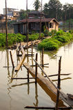 Bridge to houseboat. In the river, Thailand royalty free stock photography