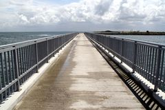 Bridge to infinity. A bridge leading off into infinity royalty free stock photos