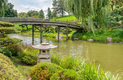 Bridge to Japanese Garden area with Japanese style stone lantern in front. stock photo