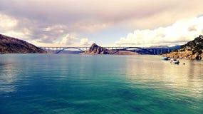 Bridge to Krk in Croatia. Bridge to island Krk in Croatia. Effected mobile photo stock photography