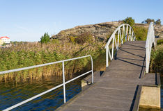 Bridge to a lonely island in the south of Sweden Stock Photos