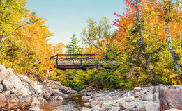 Bridge to Mary Ann Falls in the fall. (Highlands National Park, Cape Breton, Nova Scotia, Canada stock photo