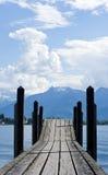 Bridge to mountain. Wooden bridge with mountain view Stock Image