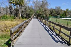 Bridge to nature trail on a sunny day. Royalty Free Stock Image