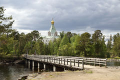 Bridge to Nicholas Skete. View on wooden bridge to Nicholas Hermitage on Valaam island in northern Russia Royalty Free Stock Photo