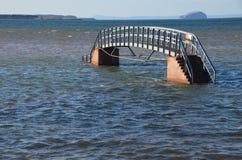 Bridge to Nowhere. An estuary bridge on the ocean in Belhaven Dunbar Scotland Royalty Free Stock Photos