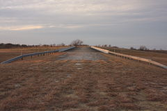Bridge. To nowhere in Fort Worth Texas, farm land on each end of the road Stock Photo