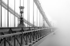 Bridge in a foggy morning Royalty Free Stock Photography