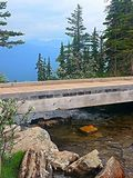 Bridge to nowhere. Wooden bridge close up over a creek and overlooking the lakes and trees in the heart of Lake louise royalty free stock images