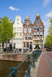 Bridge to old houses, Amsterdam Royalty Free Stock Photo