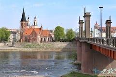 Bridge to old town, gothic church near river. royalty free stock photos