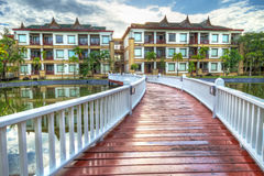 Bridge to the oriental style resort in Thailand. Oriental architecture reflected in the pond at sunrise, Thailand Royalty Free Stock Photography