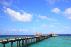 Bridge to the pier. Bridge lead to a pier on the lagoon in a tropical resort at Maldives Stock Image