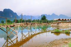 Bridge to riverside guesthouse Stock Photo