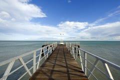 Bridge to the sea. Bridge entering into the sea in the mediterranean coast Stock Photos