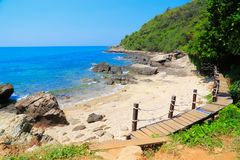 Bridge in to the sea at Rayong. Wooden bridge to a tropical beach on island with blue sky, at khao laem ya mu koh samet island Rayong Thailand Royalty Free Stock Photo