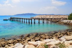 Bridge in to the sea at Rayong. Wooden bridge to a tropical beach on island with blue sky, at khao laem ya mu koh samet island Rayong Thailand Stock Photo