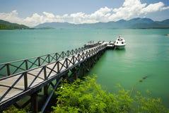 The bridge to sea with speed boat Stock Photo