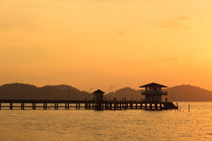 Bridge to the sea at sunset, Songkhla, Thailand. Bridge to the sea at sunset, Local pier, Songkhla, Thailand Royalty Free Stock Photo