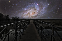 Bridge to the stars. Bridge on a distant planet near the triangulum galaxy royalty free stock images