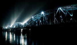 The bridge in Torun illuminated at night stock photography