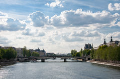 Bridge and tourist ships in the center of Paris Royalty Free Stock Image
