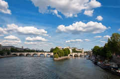 Bridge and tourist ships in the center of Paris Royalty Free Stock Images