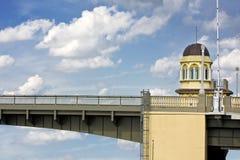 Bridge tower against cloudy blue sky Stock Photos