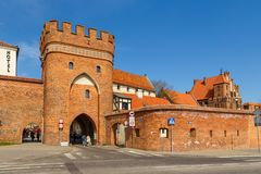 Bridge tower gate and city walls, Torun, Poland. Torun, Poland - 05 April 2014: Bridge Tower Gate and city walls. The Tower is located neighborhood of the Old Stock Photography